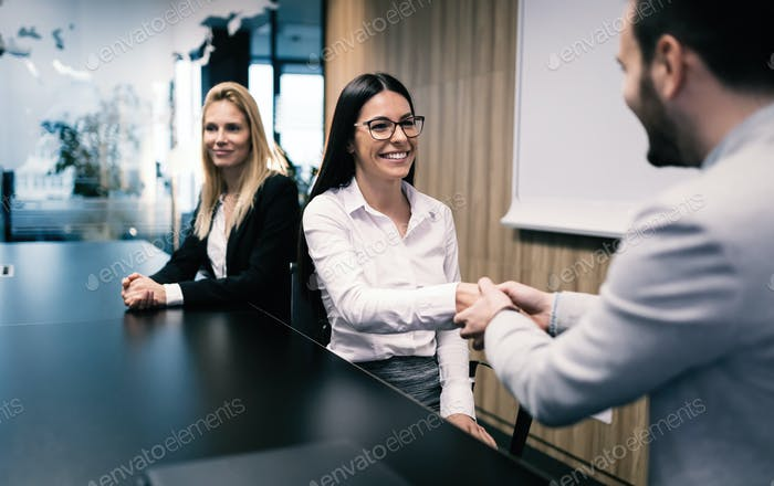 Business people agreement during board meeting