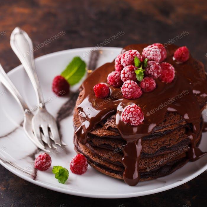 Chocolate pancake with chocolate glaze,raspberries