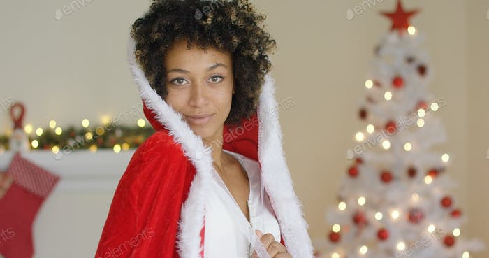 Sensual young woman in a Santa Claus outfit
