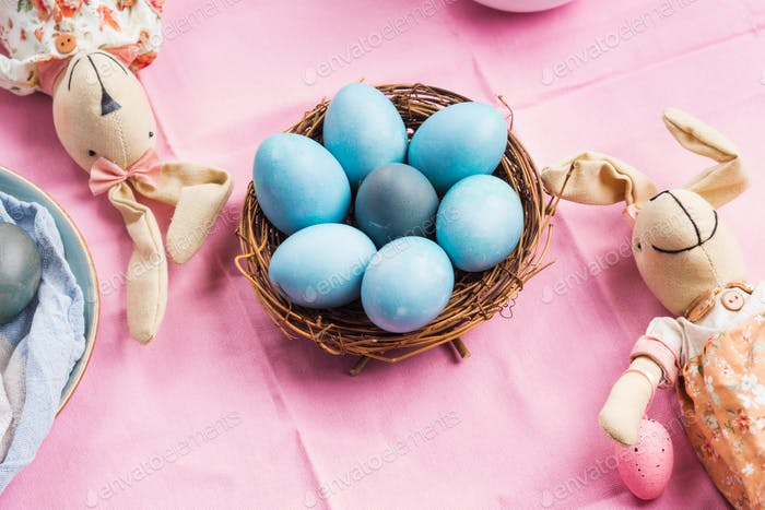 Pink easter holiday concept with bunny and eggs