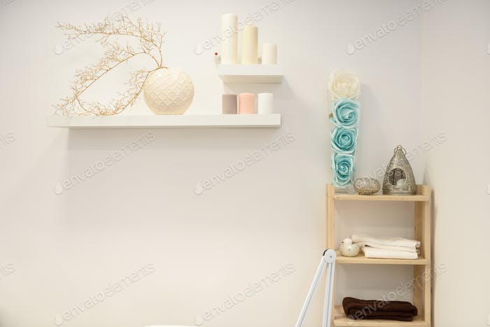 Decoration details in modern wellness center with flower vase an