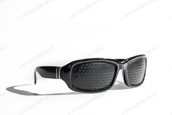 Anti Myopia Glasses with holes for vision correction on white ba