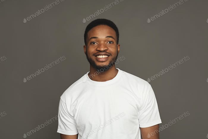 Facial expression, emotions, friendly black man smiling