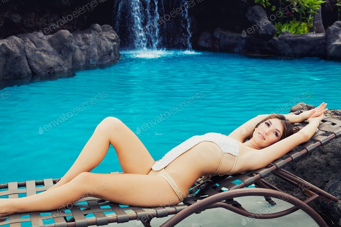Beautiful Girl Relaxing at Tropical Resort