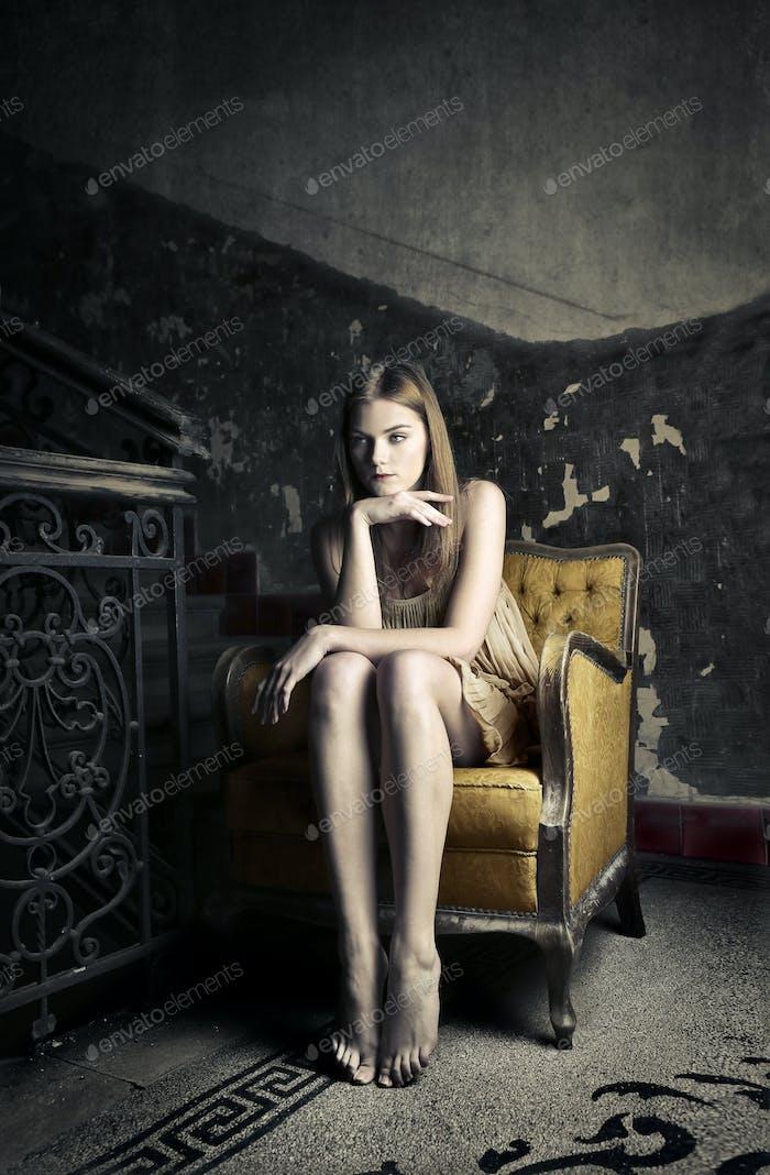 Girl sitting on an armchair