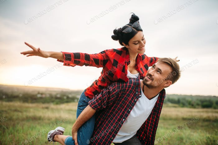 Couple leisure together, picnic in the field