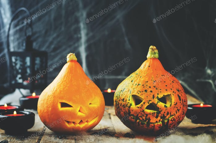 Halloween horror background with a spider's web, pumpkins, candl