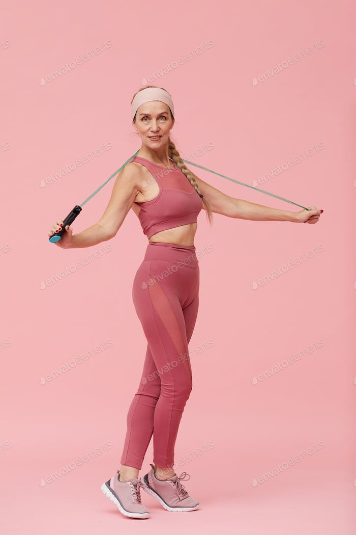 Fit Mature Woman Posing with Jumping Rope
