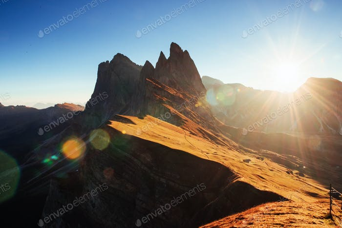 Hills is on the light. Beautiful sunset in the Italian majestic Seceda dolomite mountains