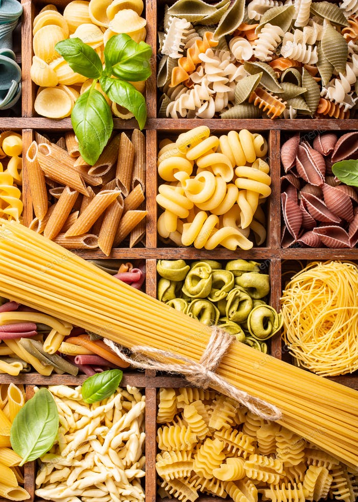 Assorted colorful italian pasta in wooden box