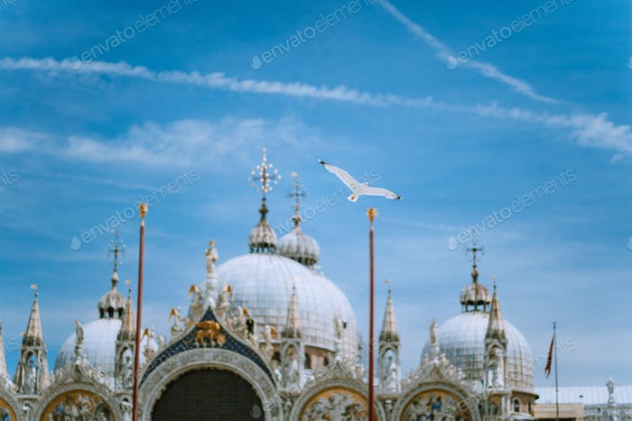 Piazza San Marco Saint Mark Square with Basilica di San Marco. Roof architecture details with flying