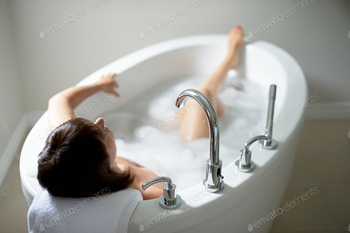 Thumbnail for Top view of a serene mature woman in bathtub