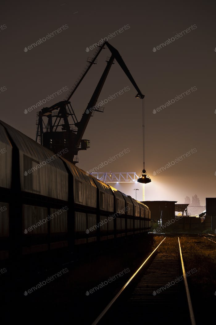 Coal Harbor Crane And Train At Night