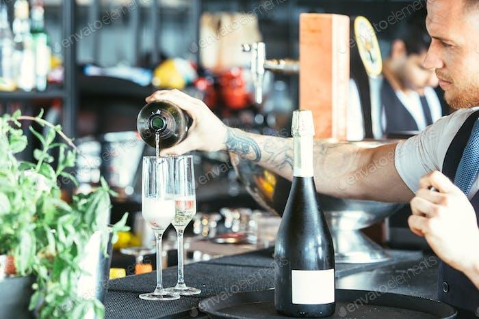 Waiter serving a cocktail