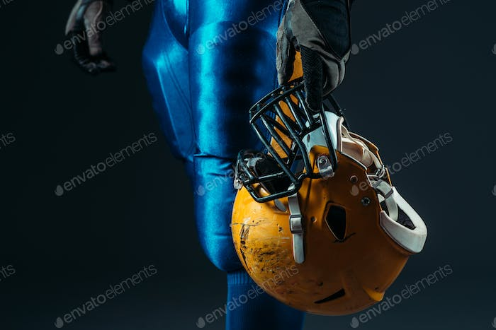 Male person in uniform with football helmet