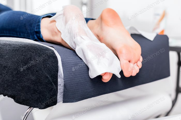 Callus peel, peeling feet procedure at beauty salon
