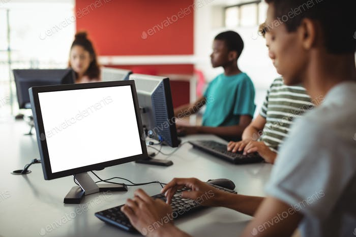 Students using computer in classroom