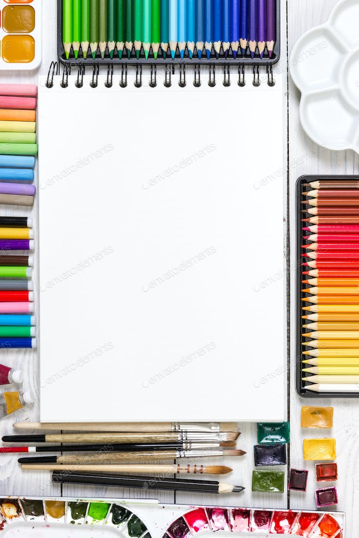 Artist workspace on white wooden background