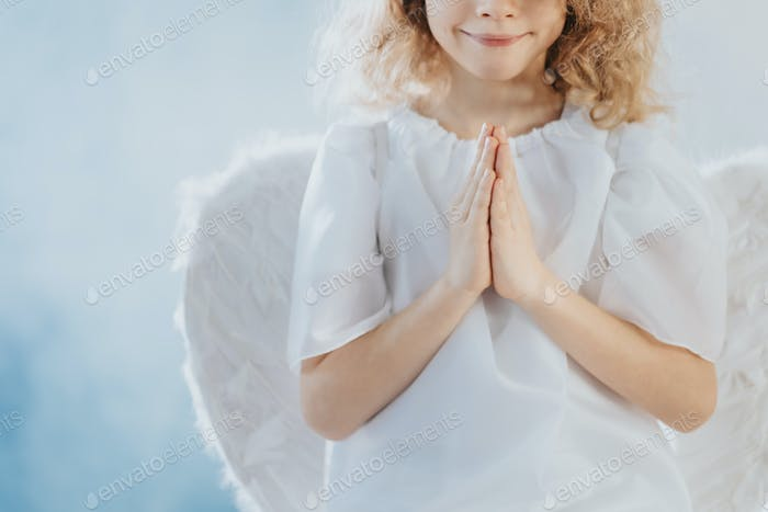 Angel with hands together