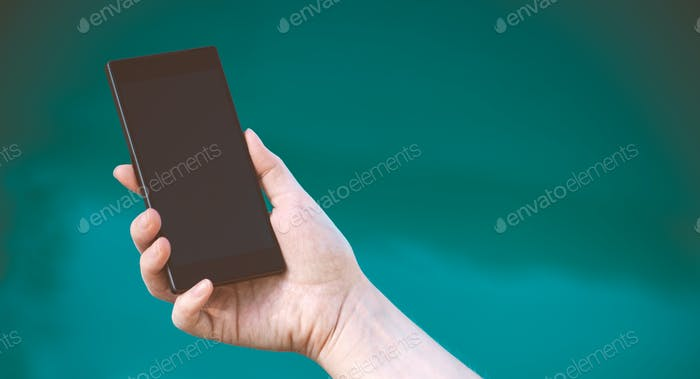 Female hand with mobile phone