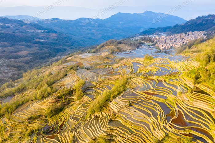 beautiful yuanyang terraced field landscape and village at dusk