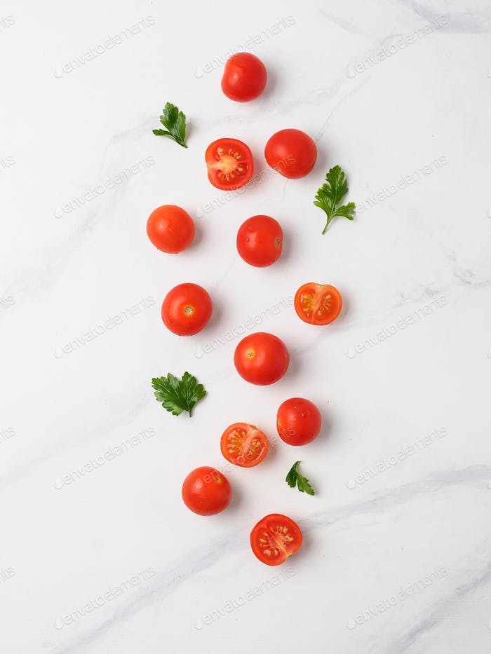 Cherry tomatoes on white marble table