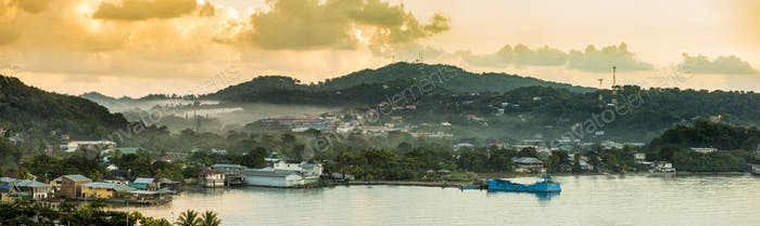 Panorama of Coxen Hole, Roatan with fog in first morning light.
