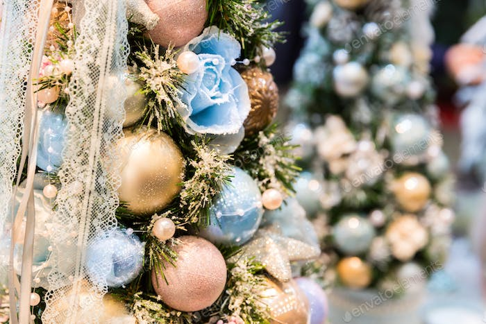 Christmas tree decorated with blue and gold balls