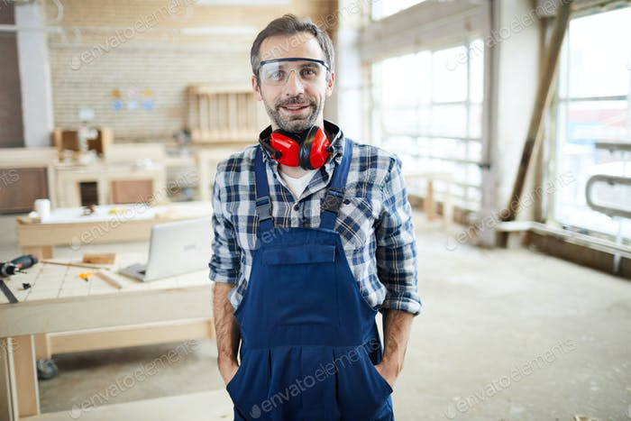 Happy joiner in workshop