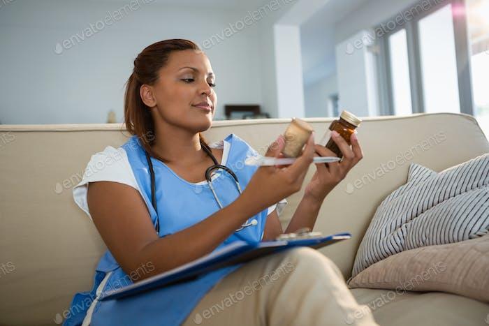 Doctor examining prescription pill bottle