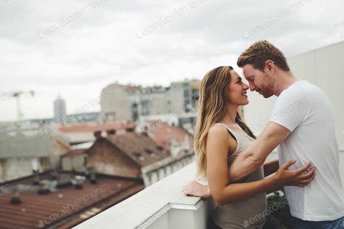 Romantic couple on rooftop