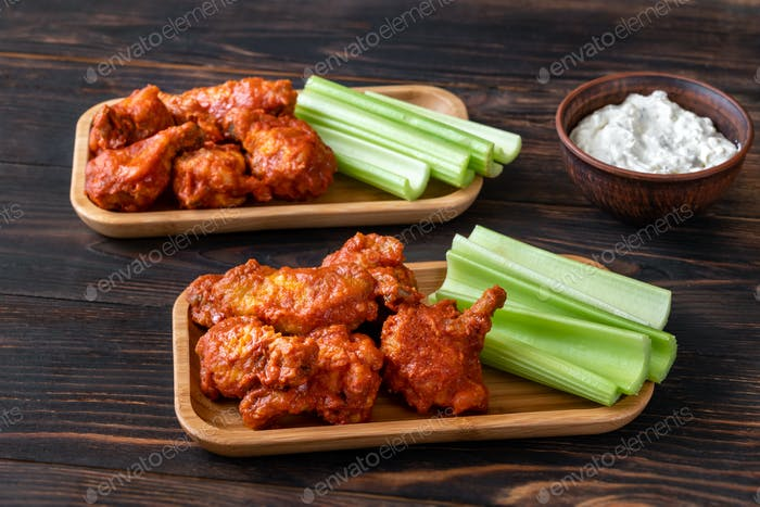 Buffalo wings with fresh celery stalks