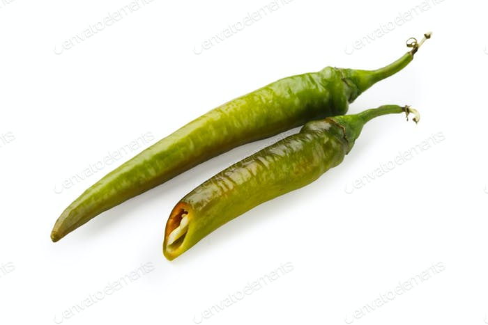 Green chili peppers closeup isolated on white background