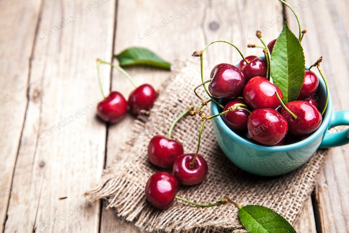 Cherry isolated on wooden background, fruits, berries