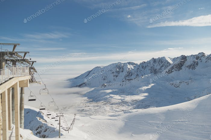 Ski resort. Landscape snowy peaks and valleys for skiing, ski slopes and lifts