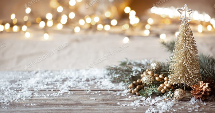 Christmas cozy background with decor details, snow and blurry lights copy space.