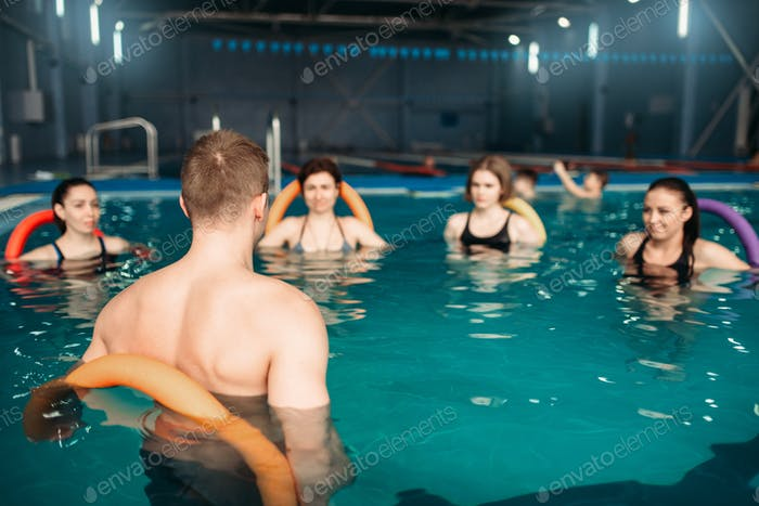 Trainer and group, workout in swimming pool