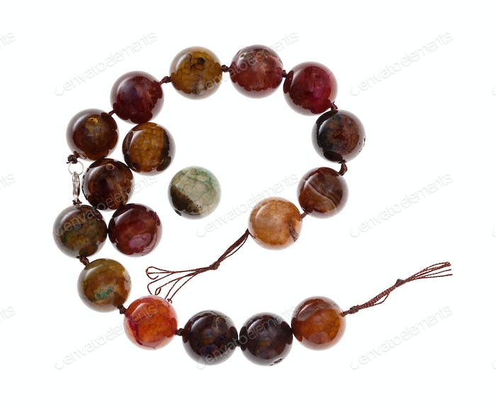 string of beads from cracked agate gemstone