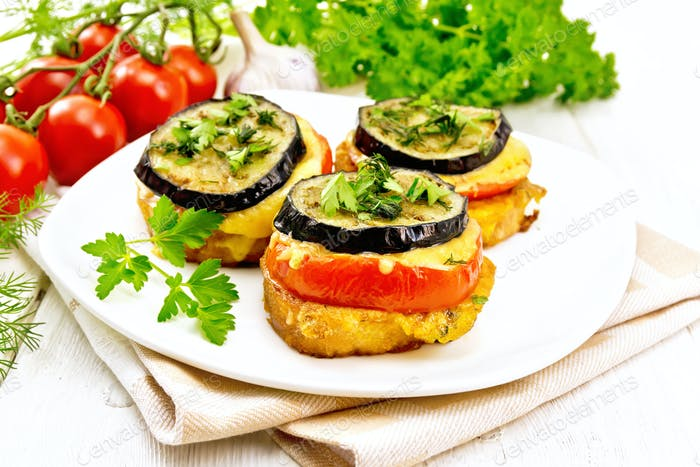 Appetizer of aubergines and cheese on napkin