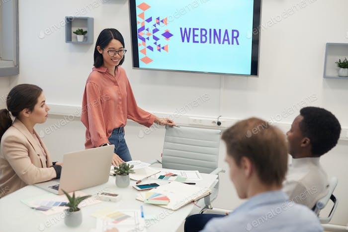 Asian Young Woman Giving Presentation