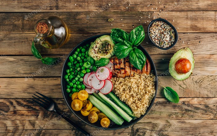 Healthy salad bowl with quinoa and chicken
