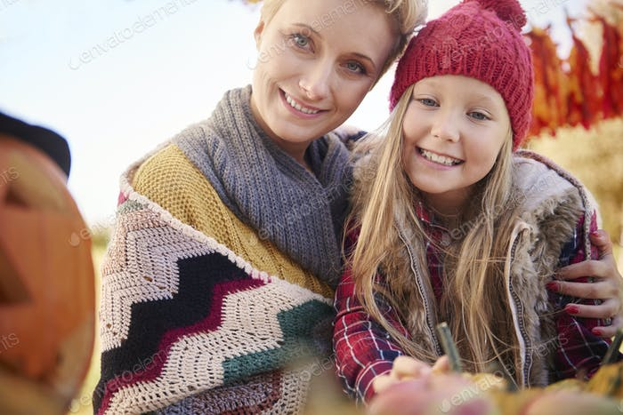 Portrait of beautiful mother and cute girl