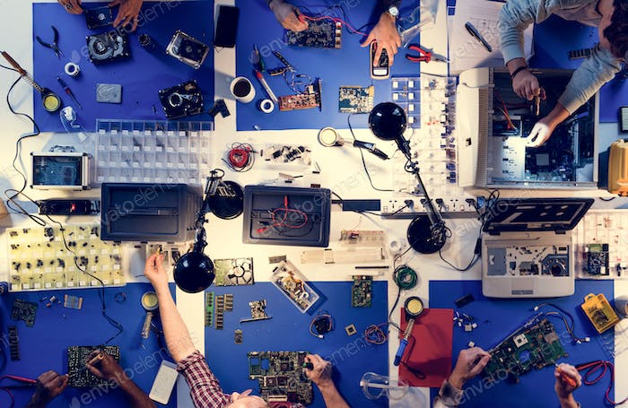 Aerial view of electronics technicians team working on computer