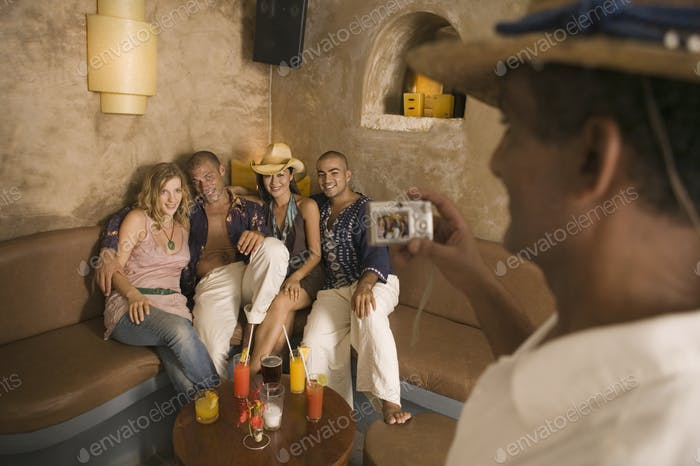 Man taking group photo with camera