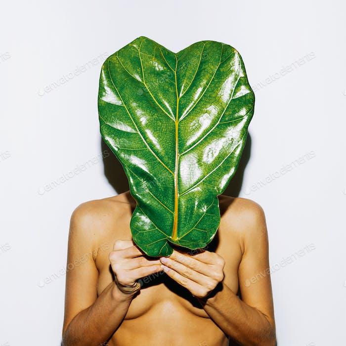 Big Green Leaf and Body. Bio concept. Modern art
