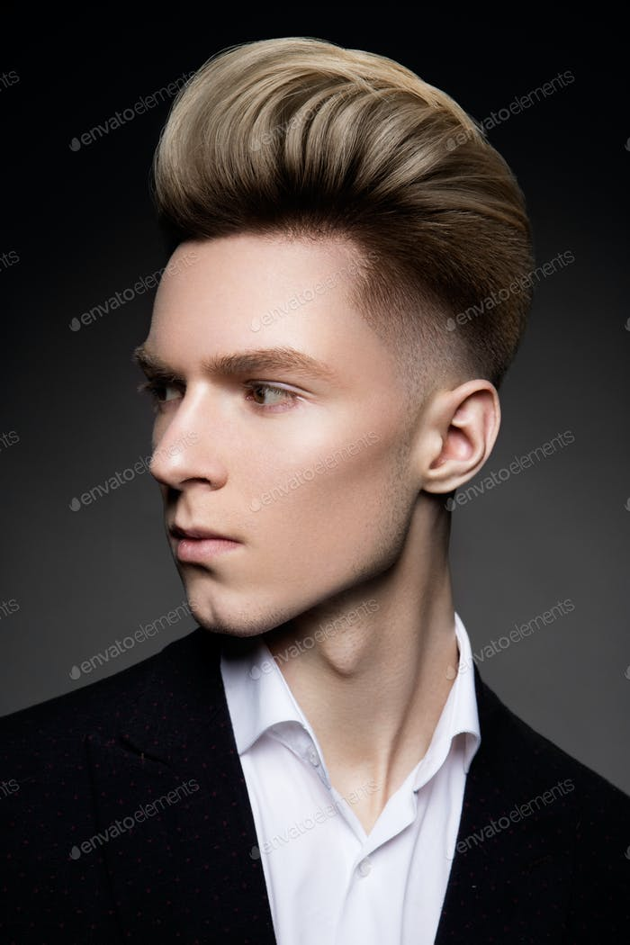 Side view portrait of thinking stylish young man
