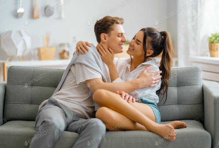couple having fun and hugging at home.