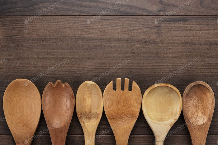 Wooden Spoons On The Blue Table