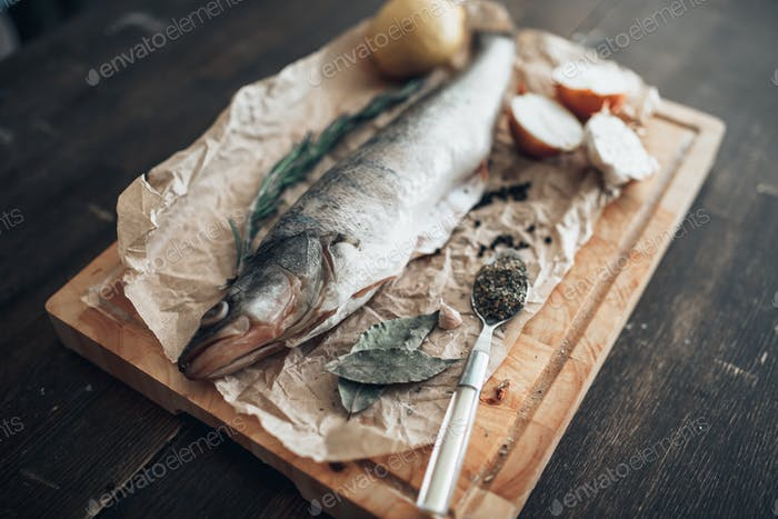 Fish preparation ingredients on cutting board