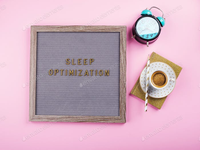 Sleep optimization text on letter board with coffee